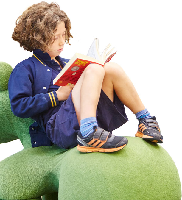 Boy reading in a Glen Eira library